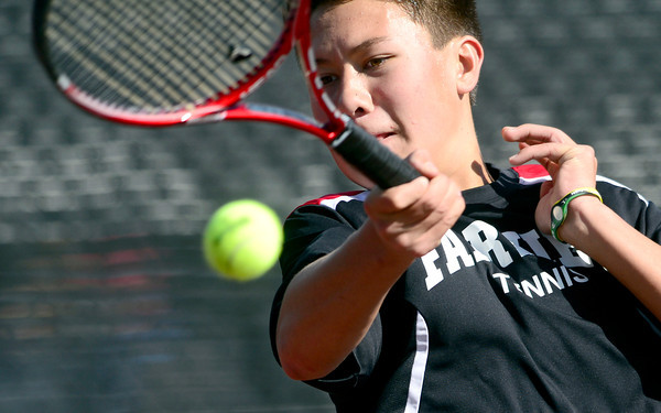 Fairview's Alec Leddon returns the the ball to Rock Canyon's Michael Shapiro during their 5A 2012 Boys' State Tennis Quarterfinal match in Denver, Colorado October 11, 2012. BOULDER DAILY CAMERA/ Mark Leffingwell