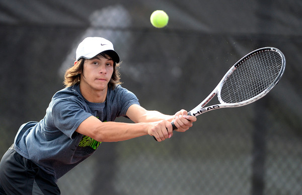 Loveland's Joey Diaz stretches for the ball while playing Chapperal's Eric Kwiatkowski during their 5A 2012 Boys' State Tennis Quarterfinal match in Denver, Colorado October 11, 2012. BOULDER DAILY CAMERA/ Mark Leffingwell