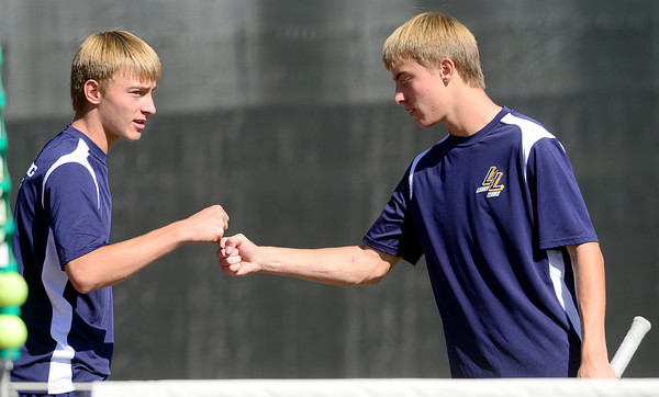 Legacy's Doubles players David Rosencrans (left) and Mike Rosencrans celebrate a point against Douglas County's Varun Katamaneni and Reese Watt during their 5A 2012 Boys' State Tennis Quarterfinal match in Denver, Colorado October 11, 2012. BOULDER DAILY CAMERA/ Mark Leffingwell