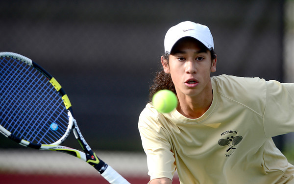 Monarch's Justin Nguyen returns the ball while playing Heritage's Ashton Blair during their 5A 2012 Boys' State Tennis Quarterfinal match in Denver, Colorado October 11, 2012. BOULDER DAILY CAMERA/ Mark Leffingwell