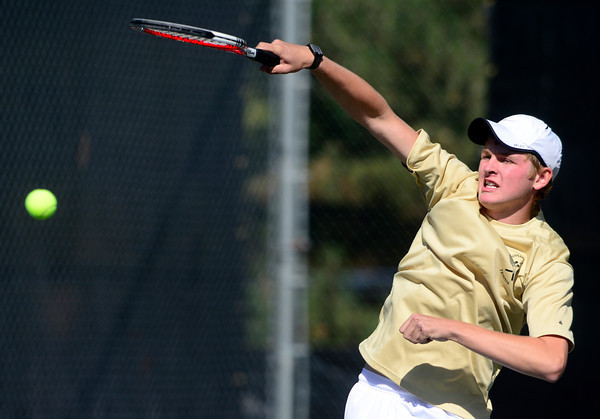 Monarch's Doubles player Jason Ferry slams the ball to Fossil Ridge's David Dummer and Basil Fleischili during their 5A 2012 Boys' State Tennis Quarterfinal match in Denver, Colorado October 11, 2012. BOULDER DAILY CAMERA/ Mark Leffingwell