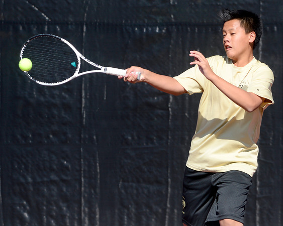 Monarch's Doubles player Jason Nguyen returns to the ball to Fossil Ridge's David Dummer and Basil Fleischili during their 5A 2012 Boys' State Tennis Quarterfinal match in Denver, Colorado October 11, 2012. BOULDER DAILY CAMERA/ Mark Leffingwell