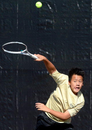 Monarch's Doubles player Jason Nguyen serves to the ball to Fossil Ridge's David Dummer and Basil Fleischili during their 5A 2012 Boys' State Tennis Quarterfinal match in Denver, Colorado October 11, 2012. BOULDER DAILY CAMERA/ Mark Leffingwell