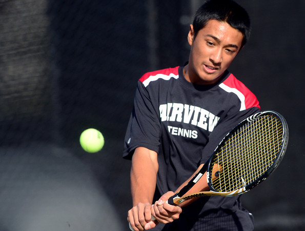 Fairview's Ignatius Castelino returns the the ball while playing Highlands Ranch's Chris Sterling during their 5A 2012 Boys' State Tennis Quarterfinal match in Denver, Colorado October 11, 2012. BOULDER DAILY CAMERA/ Mark Leffingwell