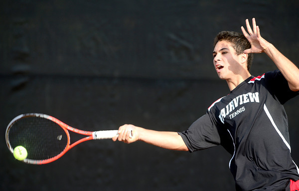 Fairview's Eli Winegardner returns the ball while playing Cherry Creeks' Dan Steinhauser during their 5A 2012 Boys' State Tennis Quarterfinal match in Denver, Colorado October 11, 2012. BOULDER DAILY CAMERA/ Mark Leffingwell