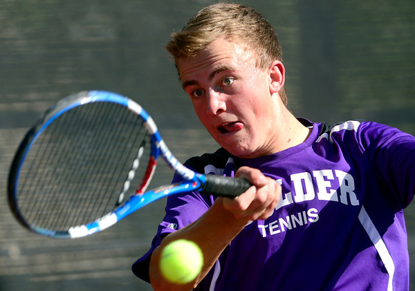 Boulder's Levi Chandler returns the the ball while playing Monarch's Danny Wright during their 5A 2012 Boys' State Tennis Quarterfinal match in Denver, Colorado October 11, 2012. BOULDER DAILY CAMERA/ Mark Leffingwell