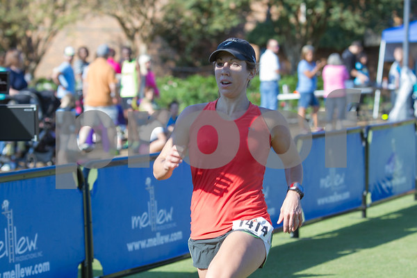 Steph Vaughn is the first Feamle Runner to cross the finish line of the Tyler Half Marathon with a time of 1:37:00.  Photo by John Murphy