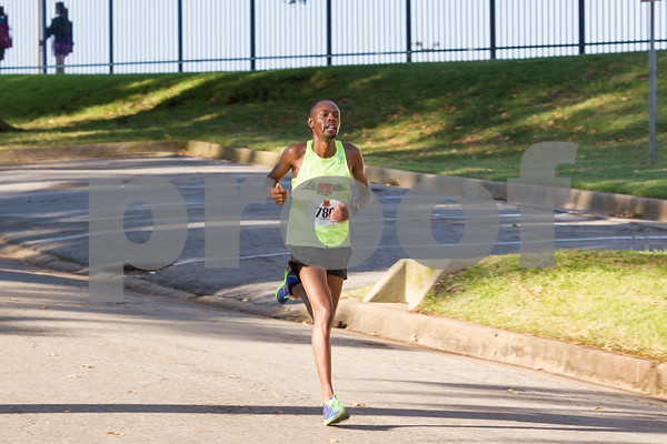 With a new course record of 1:15:51, William Songock finishes first in the Tyler Half Marathon.  Photo by John Murphy