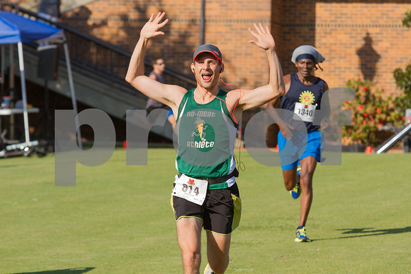 Brent Heady celebrates as he crosses the finish line of the Tyler Half Marathon with a time of 1:37:31.  Photo by John Murphy