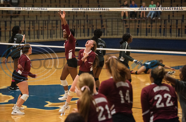 Whitehouse volleyball players celebrate after scoring a point in their game against John Tyler High School in Tyler on Tuesday Oct. 1, 2019.  (Sarah A. Miller/Tyler Morning Telegraph)