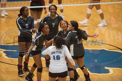 John Tyler High School volleyball players celebrate after scoring a point in their game against Whitehouse in Tyler on Tuesday Oct. 1, 2019.  (Sarah A. Miller/Tyler Morning Telegraph)
