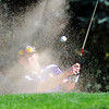 Holy Family High School's Conor Stanley chips the ball out of a sand trap and onto the 10th hole green during the 2012 CHSAA 3A State Championship held at Denver's Pinehurst Country Club on Monday, October 1, 2012. (Kira Horvath/Daily Camera)