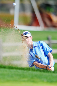 Peak to Peak High School's Jack Cavanagh chips the ball out of a sand trap and onto the 9th hole green during the 2012 CHSAA 3A State Championship held at Denver's Pinehurst Country Club on Monday, October 1, 2012. (Kira Horvath/Daily Camera)