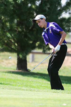 Holy Family High School's Joey Bartoletti chips the ball onto the 10th hole green during the 2012 CHSAA 3A State Championship held at Denver's Pinehurst Country Club on Monday, October 1, 2012. (Kira Horvath/Daily Camera)