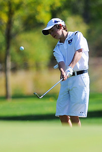 Alexander Dawson's Cole Folwell chips the ball onto the 7th hole green at the 2012 CHSAA 3A State Championship held at Denver's Pinehurst Country Club on Monday, October 1, 2012. (Kira Horvath/Daily Camera)