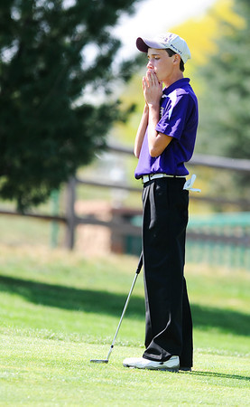 Holy Family High School's Joey Bartoletti reacts after narrowly missing his putt on the 10th hole during the 2012 CHSAA 3A State Championship held at Denver's Pinehurst Country Club on Monday, October 1, 2012. (Kira Horvath/Daily Camera)