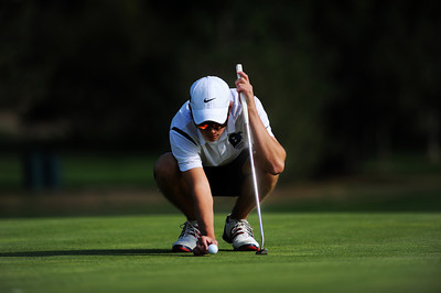 Alexander Dawson's Carson Jones carefully places his ball at his marker on the 6th hole green at the 2012 CHSAA 3A State Championship held at Denver's Pinehurst Country Club on Monday, October 1, 2012. (Kira Horvath/Daily Camera)