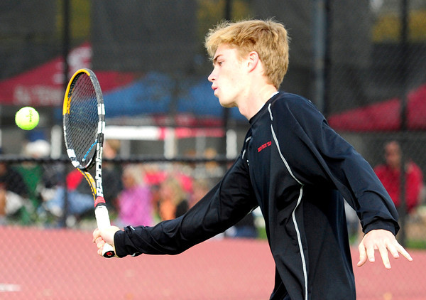 Fairview's Connor Corrigan returns the ball to Arapahoe's Chad Curd and Michael Vertuli during their 5A 2012 Boys' State Tennis Semifinal match in Denver, Colorado October 12, 2012. BOULDER DAILY CAMERA/ Mark Leffingwell