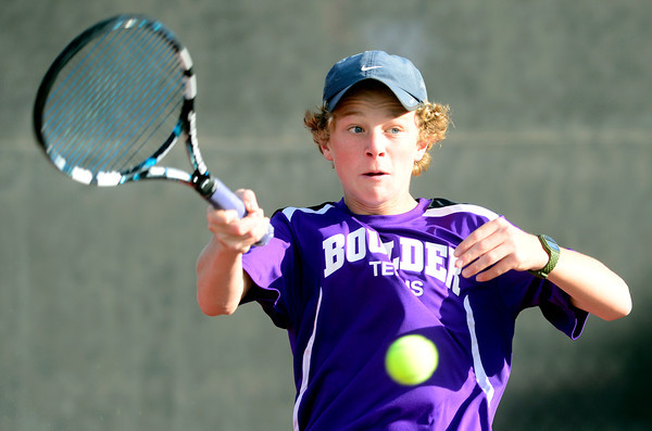 Boulder's Jackson Hawk returns the ball to Cherry Creek's Connor McPherson during their 5A 2012 Boys' State Tennis Semifinal match in Denver, Colorado October 12, 2012. BOULDER DAILY CAMERA/ Mark Leffingwell
