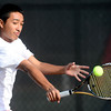 Fairview's Ignatius Castelino backhands the ball back to Arapahoe's Nick Farman during their 5A 2012 Boys' State Tennis Semifinal match in Denver, Colorado October 12, 2012. BOULDER DAILY CAMERA/ Mark Leffingwell
