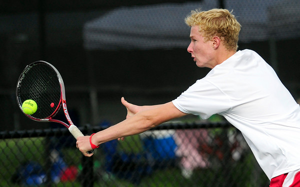 Fairview's Tommy Mason returns the ball to Legacy's David Rosencrans and Mike Rosencrans during their 5A 2012 Boys' State Tennis Semifinal match in Denver, Colorado October 12, 2012. BOULDER DAILY CAMERA/ Mark Leffingwell