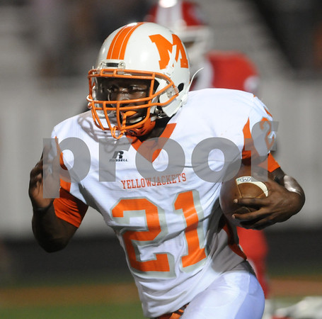 photo by Sarah A. Miller/Tyler Morning Telegraph  Mineola's running back Devon Foster carries the ball  in the first half of their game at Van Friday night.