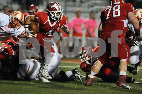 photo by Sarah A. Miller/Tyler Morning Telegraph   Van's running back Matt Savis carries the ball in the first half of their game Friday night against Mineola at Van Memorial Stadium.