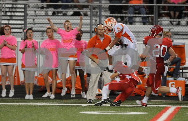 photo by Sarah A. Miller/Tyler Morning Telegraph  Mineola's Harry Elhallaoui jumps over Van's Layton Myers in the second quarter of their game Friday night at Van Memorial Stadium.