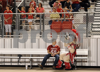 photo by Sarah A. Miller/Tyler Morning Telegraph  Joey Rowe, 10, of Van spends time with the Van High School vandal mascot during their football game against Mineola Friday night. Rowe said he likes coming to the games to watch his friend #78 offensive lineman Wyatt Santos play.