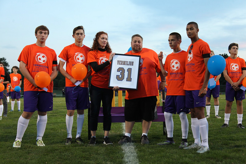 Members of the Vermilion High school soccer team dedicate the No. 31 jersey in memory of Morgan Wojciechowski on Oct. 12. Randy Meyers -- The Morning Journal