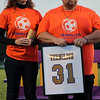 Jim and Christine Wojciechowski hold the soccer jersey dedicated in memory of their son Morgan on Oct. 12. Randy Meyers -- The Morning Journal