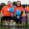 An emotional Jim and Christine Wojeiechowski sit on the bench dedicated on Oct. 12 in memory of their son Morgan. Randy Meyers -- The Morning Journal