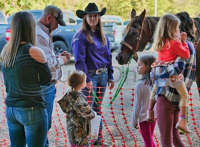 U.S. Flag Bearer Amber Greene & Horse making friends.