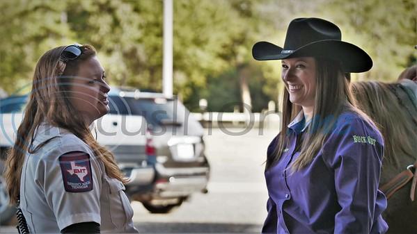 U.T. Health NE EMT with Amber Greene, American flag bearer.