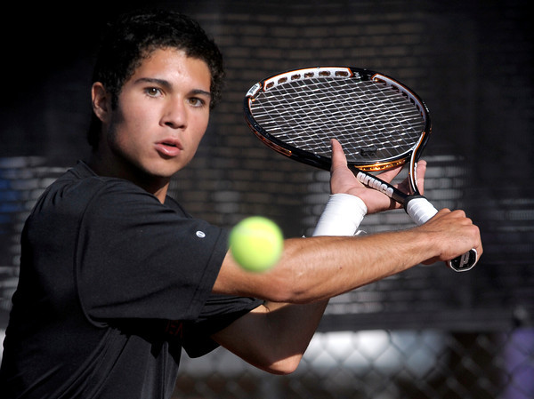 Fairview's Eli Winegardne sets up for a backhand while playing Ponderosa's Hunter LaCouture in the first round of the 2011 Boys' State Tennis in Denver, Colorado October 13, 2011.  CAMERA/Mark Leffingwell