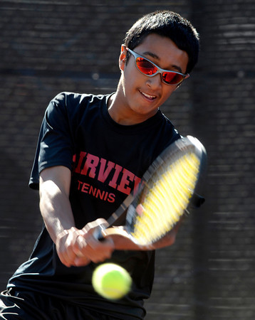 Fairview's Igantius Castelino backhands the ball back to Lakewood's Bryan Yoshida during the first round of the 2011 Boys' State Tennis in Denver, Colorado October 13, 2011.  CAMERA/Mark Leffingwell