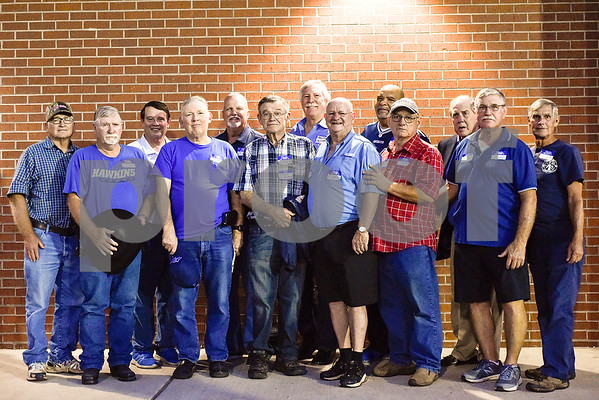 The 1967 regional championship football team poses for a photo during a high school football game at Hawkins High School in Hawkins, Texas, on Friday, Oct. 13, 2017. The 1967 regional championship football team reunited for Hawkins' homecoming game. (Chelsea Purgahn/Tyler Morning Telegraph)