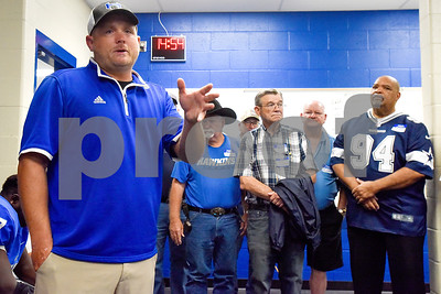 Hawkins head coach Scott Evans speaks to the varsity team and the 1967 regional championship team during a high school football game at Hawkins High School in Hawkins, Texas, on Friday, Oct. 13, 2017. The 1967 regional championship football team reunited for Hawkins' homecoming game. (Chelsea Purgahn/Tyler Morning Telegraph)