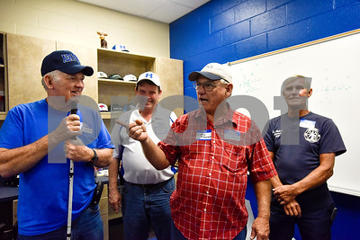 Eston Mooney, second from right, speaks to the Hawkins varsity football team on behalf of the 1967 regional championship team during a high school football game at Hawkins High School in Hawkins, Texas, on Friday, Oct. 13, 2017. The 1967 regional championship football team reunited for Hawkins' homecoming game. (Chelsea Purgahn/Tyler Morning Telegraph)