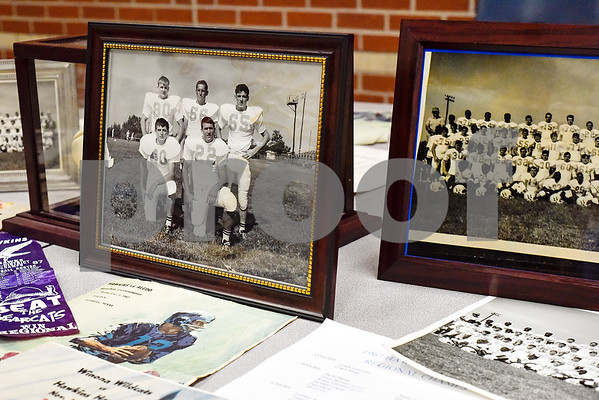 Old photos of the Hawkins football team at a reunion during a high school football game at Hawkins High School in Hawkins, Texas, on Friday, Oct. 13, 2017. The 1967 regional championship football team reunited for Hawkins' homecoming game. (Chelsea Purgahn/Tyler Morning Telegraph)