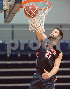 photo by Sarah A. Miller/Tyler Morning Telegraph  University of Texas at Tyler basketball player Kyle Cook makes a slam dunk in the slam dunk competition during the Patriot Madness, Meet the UT Tyler basketball teams event at the Herrington Patriot Center Wednesday night.