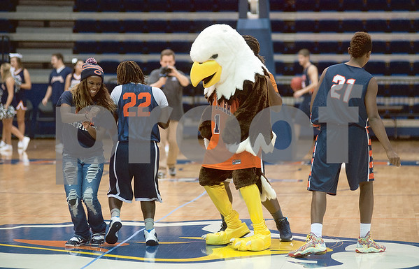 photo by Sarah A. Miller/Tyler Morning Telegraph  University of Texas at Tyler basketball players and students dance with mascot Swoop during Patriot Madness, a meet the UT Tyler basketball teams event at the Herrington Patriot Center Wednesday night.
