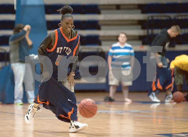photo by Sarah A. Miller/Tyler Morning Telegraph  Bianca Johnson of Dallas holds her shorts up as she dribbles down the court in a competition during Patriot Madness, a meet the UT Tyler basketball teams event at the Herrington Patriot Center Wednesday night.