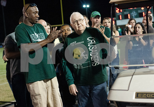 The 1995 Bishop Thomas K. Gorman state football championship team is honored at Friday's homecoming game at McCallum Stadium in Tyler. Pictured at center is then coach Bo Wilson.  (Sarah A. Miller/Tyler Morning Telegraph)