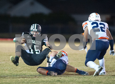 Brook Hill's Joseph Ardi (56) stops Bishop Thomas K. Gorman's Michael Goodwin (15) during the Crusader's homecoming game at McCallum Stadium in Tyler.   (Sarah A. Miller/Tyler Morning Telegraph)