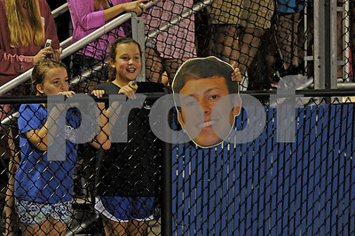 Young Cougar fans watch the game while holding an over-sized head of Cougars quarterback Chandler Nutt (4) on Friday, Oct. 17, 2014, during Grace Community's game against cross-town rival All Saints Episcopal at Mewbourne Field in Tyler. Many of Grace Community's student body brought players' heads to the game. (Derek Kuhn/Staff)