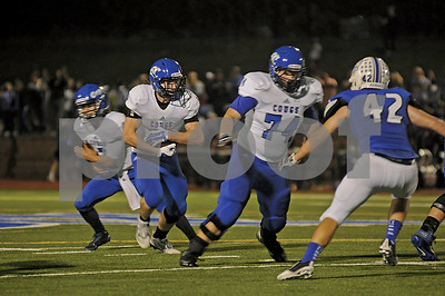 Cougars running back Zach Tatman (5) finds a hole as offensive lineman Ronnie Baker (74) looks for a downfield block on Friday, Oct. 17, 2014, during Grace Community's game against cross-town rival All Saints Episcopal at Mewbourne Field in Tyler. (Derek Kuhn/Staff)