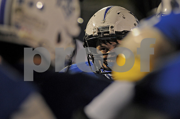 A Trojan player gets coached up during a timeout on Friday, Oct. 17, 2014, during Grace Community's game against cross-town rival All Saints Episcopal at Mewbourne Field in Tyler. (Derek Kuhn/Staff)