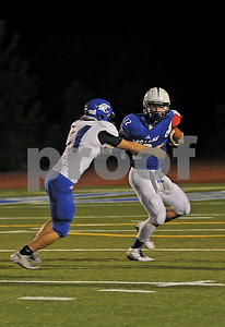 Trojans quarterback Matt Brunson (12) tries to escape the pressure of a Cougars defender on Friday, Oct. 17, 2014, during Grace Community's game against cross-town rival All Saints Episcopal at Mewbourne Field in Tyler. (Derek Kuhn/Staff)