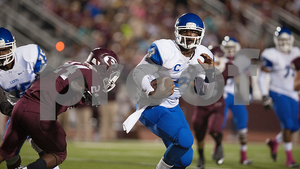 photo by Sarah A. Miller/Tyler Morning Telegraph  John Tyler's (3) Geovari McCollister carries the ball during their game Friday Oct. 17, 2014 at Lion Memorial Stadium in Ennis.
